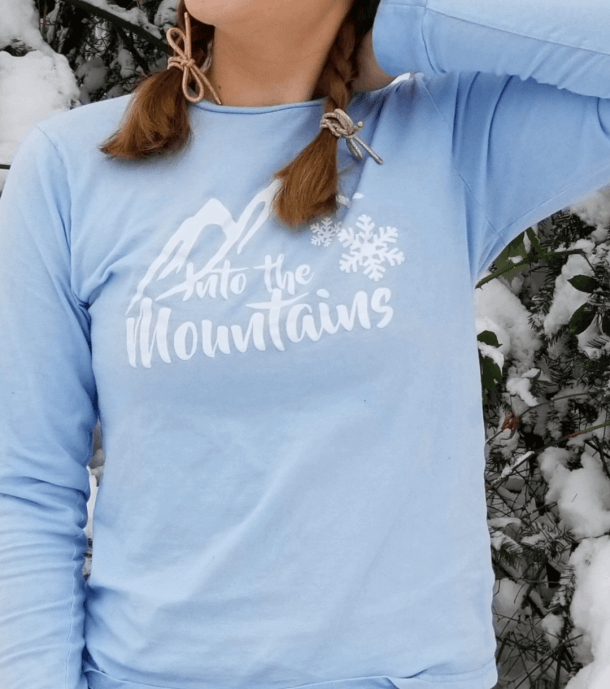 Into the Mountains Snowflake Tee Shop